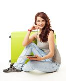 Nice smiling girl with her luggage Stock Photo