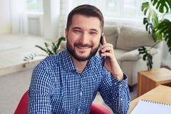 Nice smiling male talking on telephone. Close-up nice smiling male talking on telephone Royalty Free Stock Image