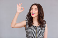Nice smiling woman giving a wink Stock Photography