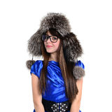 Nice smiling young teen in fur hat and glasses Royalty Free Stock Image