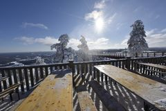 Snowy winterday in Branäs Sweden. Nice snowy winderday in Branäs Sweden 2018. Picture taken at the top with bridge in view. Tables in foreground Stock Photography