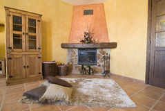 A nice space by the fireplace. Royalty Free Stock Photo