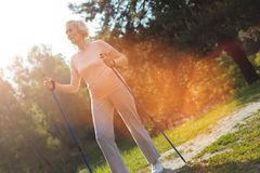 Nice sporty woman being in the park Royalty Free Stock Image
