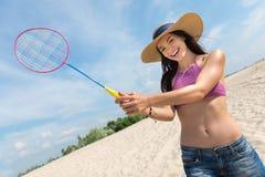 Nice sporty woman playing badminton Royalty Free Stock Photo