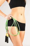 Nice sporty women body. Holding rope Royalty Free Stock Image