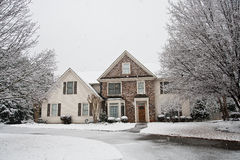 Nice Stone Faced House in Snow Stock Image