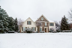 Nice Stone and Siding House After Heavy Snow stock photo
