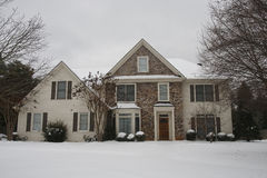Nice Stone and Siding House in Snow Royalty Free Stock Photo