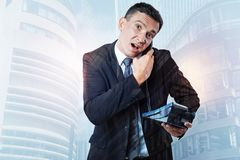 Nice stressed out businessman holding receiver Royalty Free Stock Photography