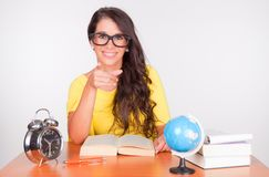 Nice student at the desk stock photography