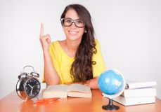 Nice student at the desk stock images