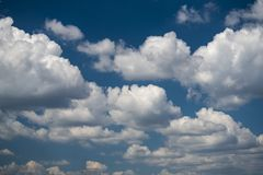 Summer blue sky and clouds background. Nice summer day clouds blue sky Stock Photos