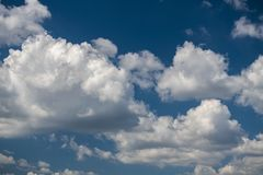 Summer blue sky and clouds background. Nice summer day clouds blue sky Stock Photography