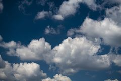 Summer blue sky and clouds background. Nice summer day clouds blue sky Stock Image