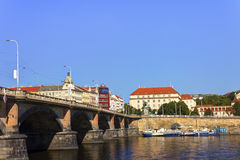 Nice summer day in Prague with Vltava river in flowing through the city and a bridge on the left Royalty Free Stock Photos
