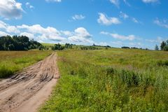 Nice summer scene with track road Royalty Free Stock Images