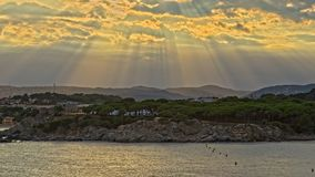 Nice sunbeams over the coastal in Costa Brava in Spain. At the sunset time Royalty Free Stock Images