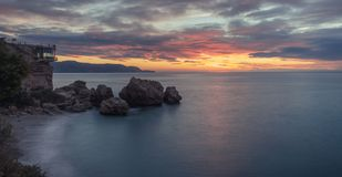 Nice sunrise en Nerja village stock photo