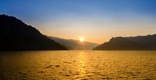 Nice sunrise over mountain and lake stock photos