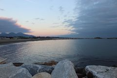 The nice sunset at the beach in Italy. This photo was Made on a afternoon in a place that called Marina di Massa in Italy with a view to the ocean. There was a royalty free stock photos