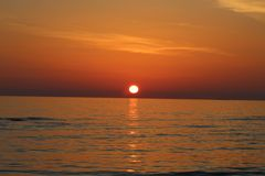 The nice sunset at the beach in Italy. This photo was Made on a afternoon in a place that called Marina di Massa in Italy with a view to the ocean. There was a stock images