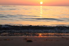 The nice sunset at the beach in Italy. This photo was Made on a afternoon in a place that called Marina di Massa in Italy with a view to the ocean. There was a stock photography