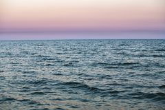 Nice sunset on blue sea nature abstract. Purple sunset sky on Black sea nature abstract Royalty Free Stock Photography