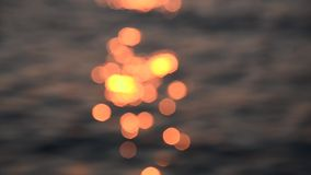 Nice sunset light bokeh on sea wave stock video