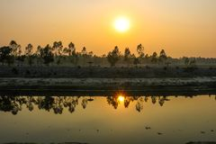 Nice Sunset moment at evening on small river. Nice Sunset moment at evening Sena kunjo park beside river Stock Photo