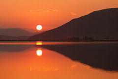 Nice sunset over lake surface Stock Image