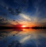 Nice sunset over lake water Stock Photo
