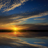 Nice sunset over water Royalty Free Stock Photos