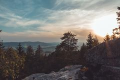 Nice sunset on rock with trees and valley, czech landscape stock photo