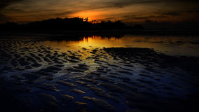 Nice sunset sky and sea at low tide in Payam island Royalty Free Stock Photos
