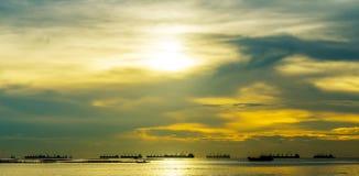 Nice sunset sky with silhouette of cargo ship Stock Image