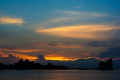 Nice sunset sky with silhouette of island Royalty Free Stock Photography