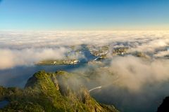 Sunset view from Festvagtinden above clouds, Lofoten, Norway. Nice sunset view from Festvagtinden above clouds, Lofoten, Norway Stock Photography