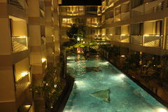 Nice swimming pool in night at a local resort stock photography