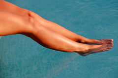 Nice tanned legs under the water Royalty Free Stock Image
