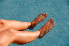 Nice tanned legs under the water Royalty Free Stock Images