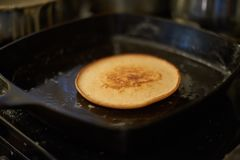 Breakfast pancake cooking on the pan. A nice tasty pancake cooking on the grill!  Enough to make anyone`s mouth water Royalty Free Stock Photography