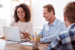Nice teacher sitting with his student Royalty Free Stock Images