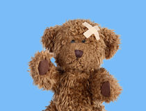 Nice teddybear with a band-air Stock Images