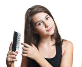 Nice teen girl combs hair and smiles Royalty Free Stock Images