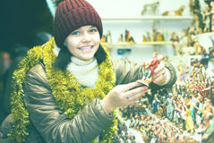 Nice teen girl  with miniature Christmas figures scenes Stock Photo