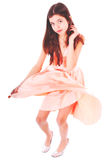 Nice teen girl in pink dress. On white Royalty Free Stock Photo