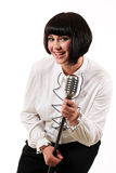 Nice teen girl singing with a microphone isolated Stock Photography