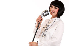 Nice teen girl singing with a microphone isolated Stock Images