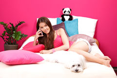 Nice teenager making a phone call in her room Stock Photos