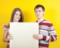 Nice teens with banner royalty free stock photo